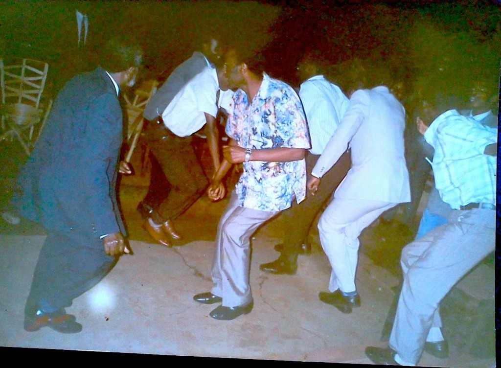 At my brother's graduation party. Dad in a blue suit, the guy facing him uncle Baira, also his best man. They danced Kikiga dance until the floor cracked as you can see.